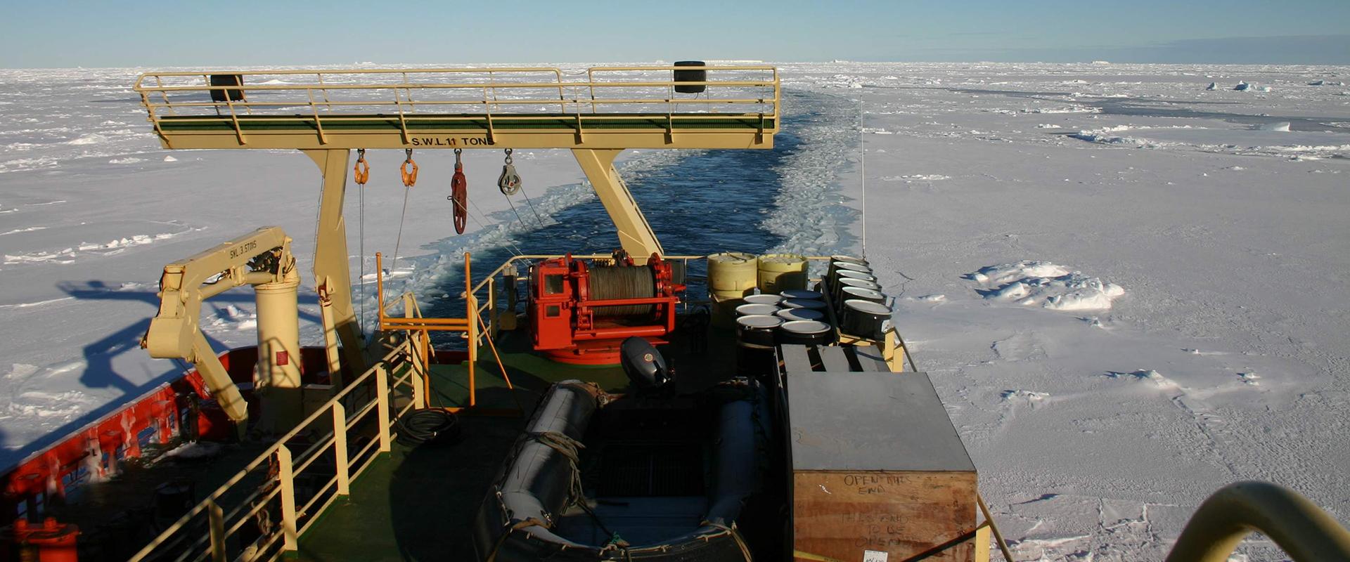 Ship breaking through ice