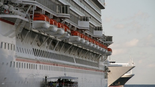 lifeboats ported on the side of a cruise ship