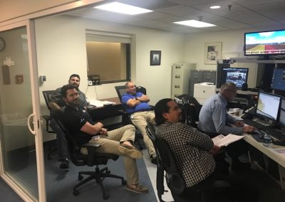 Men sitting and watching a simulation
